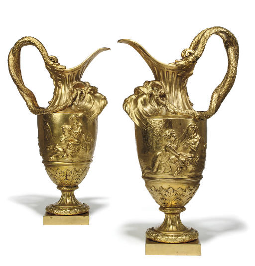 A PAIR OF ORMOLU ORNAMENTAL EWERS