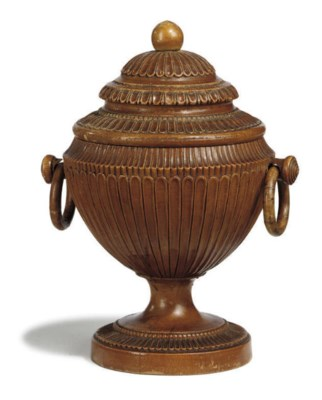 A FRENCH FRUITWOOD URN AND COV