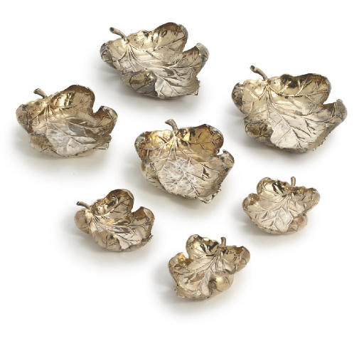 A SET OF SEVEN PORTUGUESE SILVER-GILT DISHES