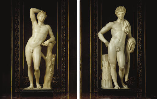 TWO CARVED MARBLE FIGURES OF T
