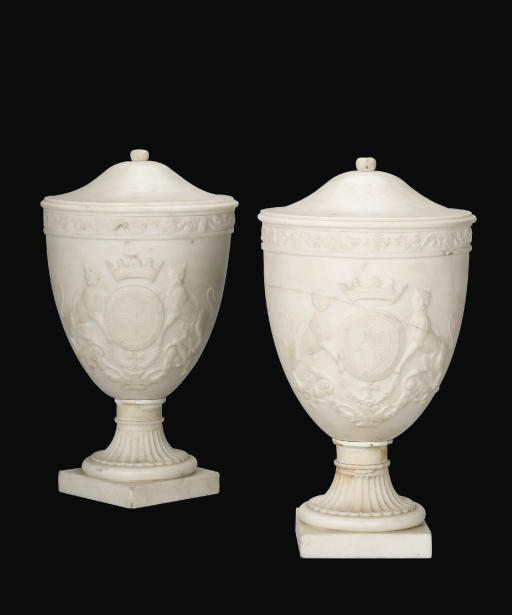 A PAIR OF CARVED MARBLE URNS