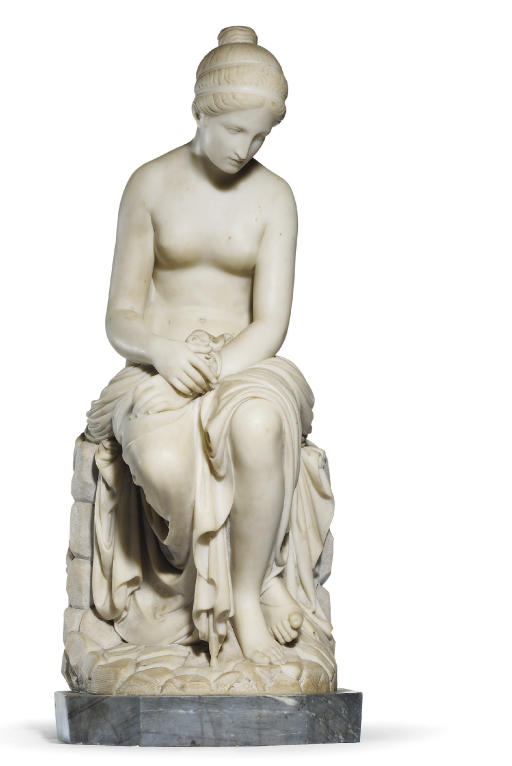 A CARVED MARBLE FIGURE OF A SE