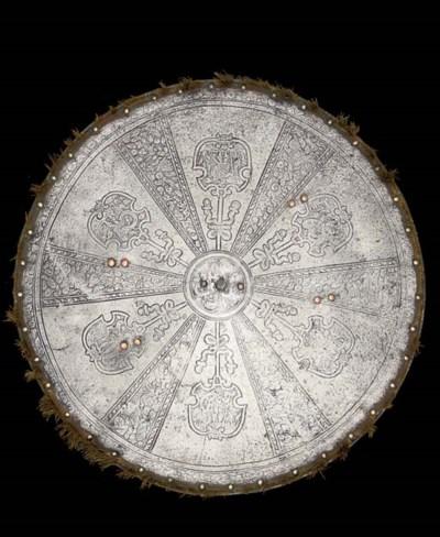 AN ITALIAN ETCHED CIRCULAR SHI