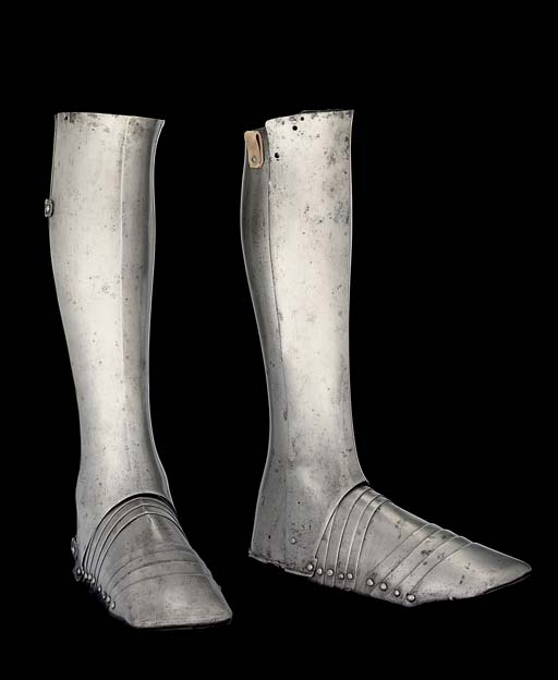 A PAIR OF GERMAN GREAVES AND S