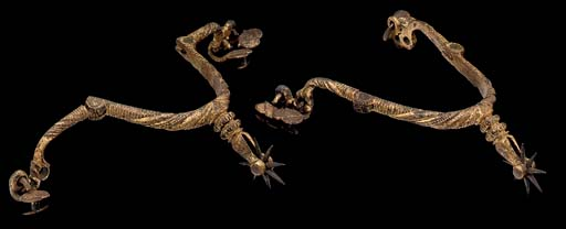 A FINE PAIR OF GILT-IRON ROWEL