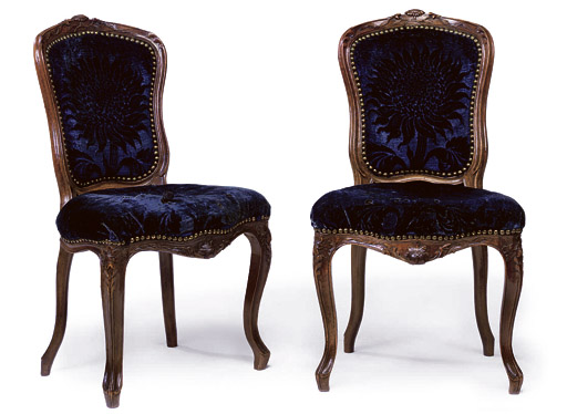 A PAIR OF LOUIS XV PROVINCIAL WALNUT CHAISES