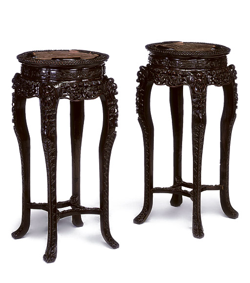 A PAIR OF CHINESE HARDWOOD URN-STANDS