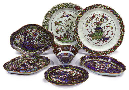 A GROUP OF CHINESE FAMILLE ROSE PLATES AND CLOBBERED DISHES