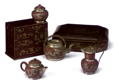 A JAPANESE PARCEL-GILT RED LAC