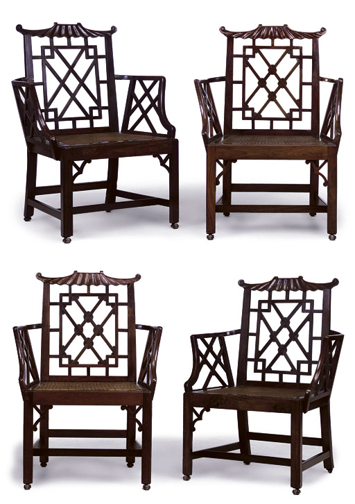 A SET OF FOUR CHINESE EXPORT PADOUK PAGODA OPEN ARMCHAIRS