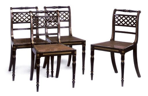 A SET OF FOUR REGENCY EBONISED AND PARCEL-GILT SIDE CHAIRS