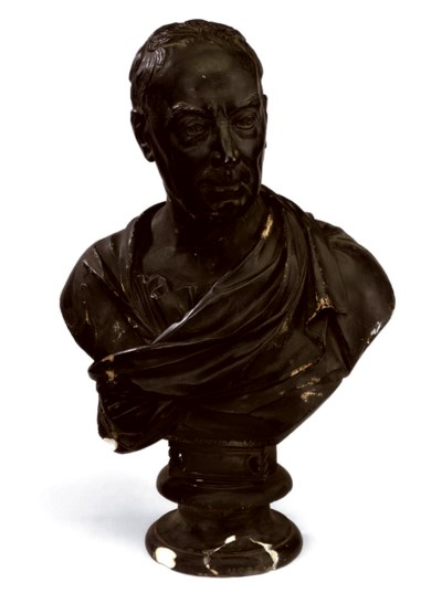 A GEORGE III EBONISED PLASTER