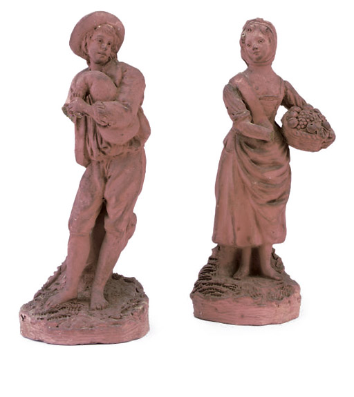 A PAIR OF FRENCH OR FLEMISH TERRACOTTA FIGURES OF PEASANTS