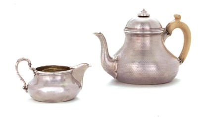 A VICTORIAN SILVER TEAPOT AND