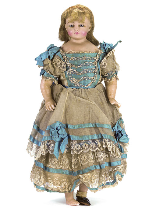 AN ENGLISH POURED WAX CHILD DOLL