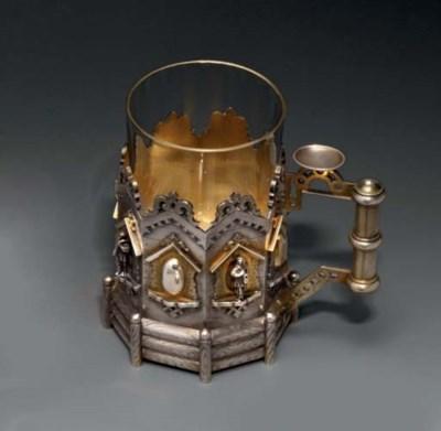 A silver tea-glass holder