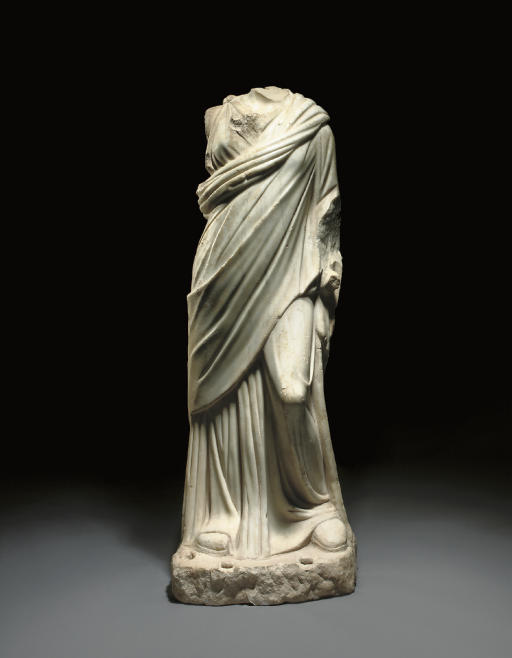 marble female figure Bust of a woman, roman, about ad 130  carved fully in the round in a satiny  white marble, the figure was designed to be viewed from multiple angles.