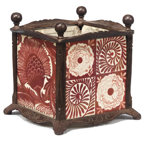 A CAST IRON JARDINIÈRE INSET WITH 'ROSE AND SCROLL' AND 'BBB' RUBY LUSTRE TILES DESIGNED BY WILLIAM DE MORGAN
