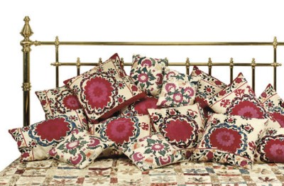 FIFTEEN CUSHIONS COVERED WITH