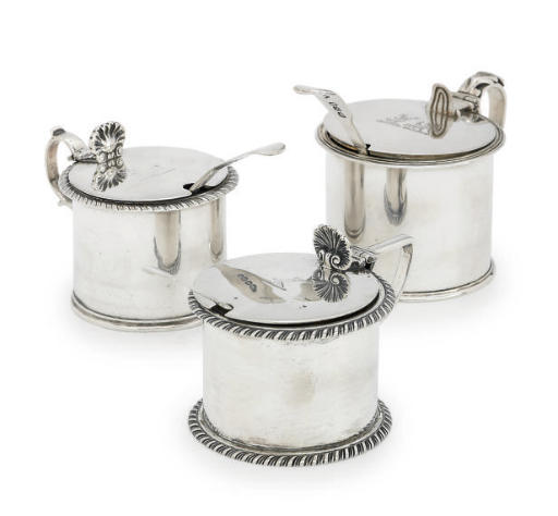 TWO VICTORIAN SILVER MUSTARD-POTS AND A GEORGE V SILVER MUSTARD-POT
