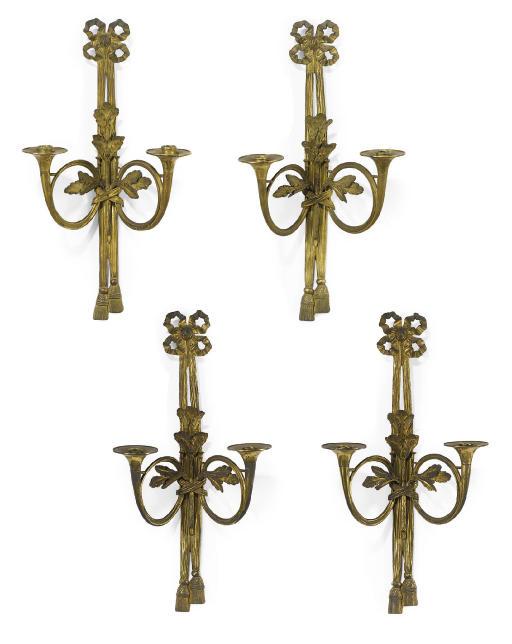 A SET OF FOUR LOUIS XVI STYLE ORMOLU TWO-LIGHT APPLIQUÉS