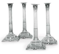 A SET OF FOUR GEORGE III SILVER CANDLESTICKS
