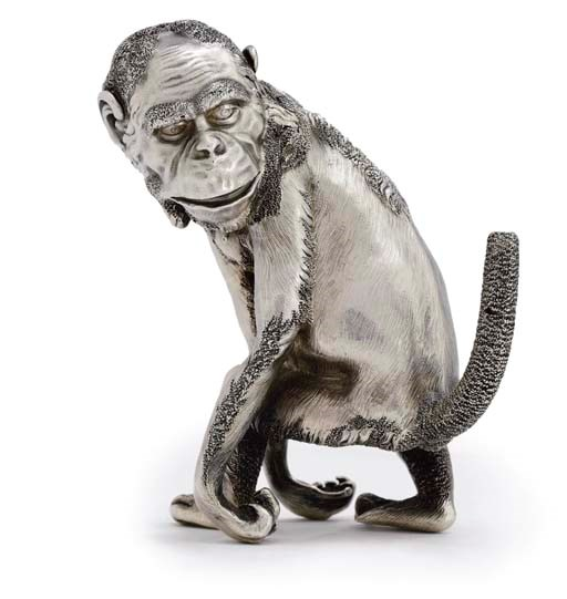 A Russian silver cigar lighter in the form of a chimpanzee, marked Fabergé with the imperial warrant, 1896-1908. 4⅜  in (11  cm) high. Sold for £168,000 on 27 June 2007 at Christie's in London