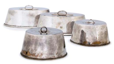 A SET OF FOUR SILVER-PLATED DI