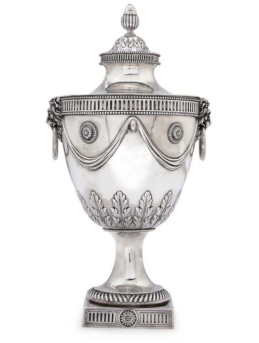 A SILVER VASE AND COVER