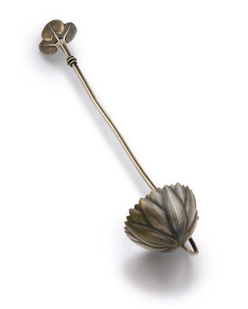 A SILVER LADLE IN THE FORM OF