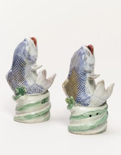 A pair of Arita models of carp