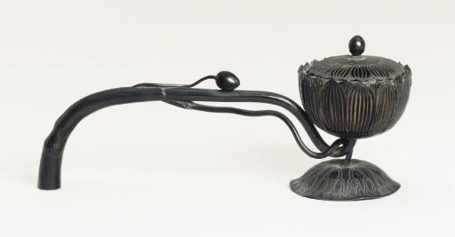 A long-handled bronze censer [