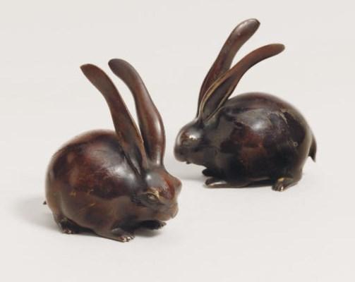 A pair of bronze okimono [scul