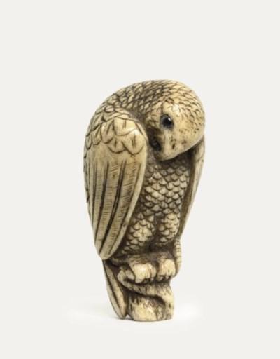 An ivory netsuke of a hawk
