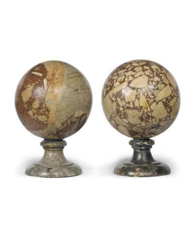 A PAIR OF CARVED MARBLE SPHERE