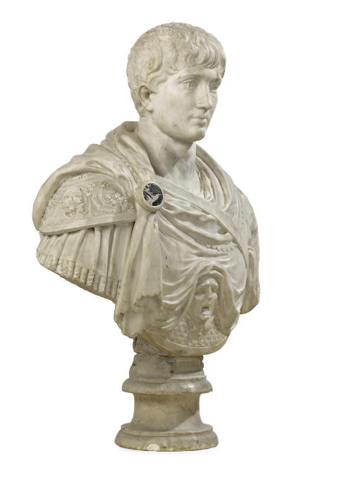 A CARVED MARBLE BUST OF A ROMA