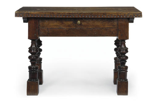 AN ITALIAN WALNUT CENTRE TABLE