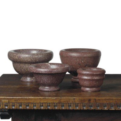 A GROUP OF FOUR PORPHYRY MORTA
