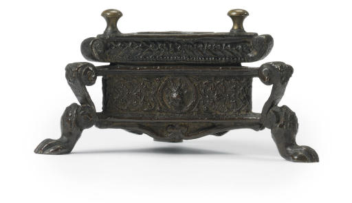 A BRONZE TRIPARTITE INKWELL