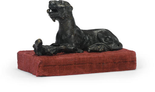 A BRONZE MODEL OF A PANTHER AT