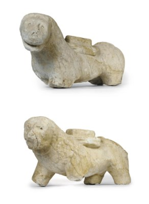 A PAIR OF FRAGMENTARY CARVED M