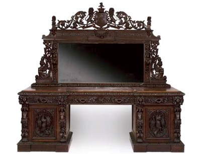A MID-VICTORIAN CARVED OAK PED