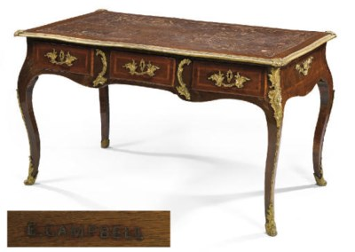 A FRENCH ORMOLU MOUNTED MAHOGA