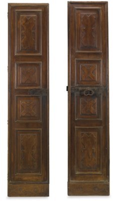 A PAIR OF ITALIAN WALNUT DOORS