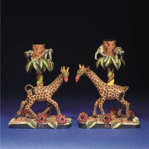 A PAIR OF GIRAFFE CANDLESTICKS