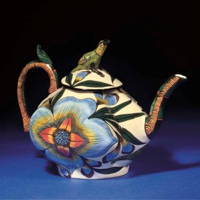 A BIRD TEAPOT AND COVER