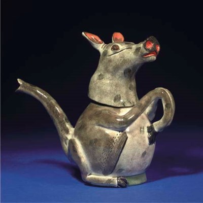 AN ANTEATER TEAPOT AND COVER