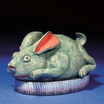 A RABBIT BUTTER DISH AND COVER