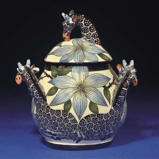 A GIRAFFE TUREEN AND COVER