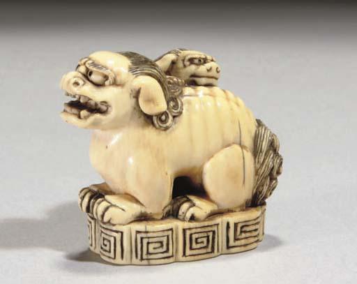A Japanese ivory seal netsuke with a Karashishi and cub, 19th Century